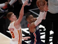Washington Wizards' Russell Westbrook, right, shoots past Atlanta Hawks' Kevin Huerter on his way to setting the NBA's new career triple-double record (Ben Margot/AP)