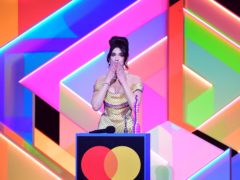 Dua Lipa accepts the award for Female Solo Artist during the Brit Awards 2021 at the O2 Arena (PA)