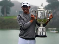 Collin Morikawa holds the Wanamaker Trophy after winning the 2020 US PGA Championship (Jeff Chiu, File/AP)