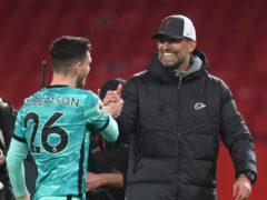 Liverpool manager Jurgen Klopp with Andrew Robertson (Michael Regan/PA)
