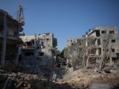 Palestinians inspect their destroyed houses following overnight Israeli air strikes in town of Beit Hanoun, northern Gaza (Khalil Hamra/AP)