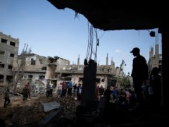 Palestinians inspect their destroyed houses following overnight Israeli air strikes in town of Beit Hanoun, northern Gaza Strip (Khalil Hamra/AP)