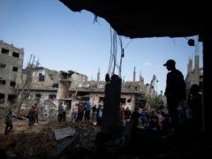 Palestinians inspect their destroyed houses following overnight Israeli air strikes in town of Beit Hanoun, northern Gaza Strip (Khalil Hamra/AP)