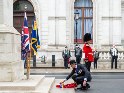 National President of the Royal British Legion Lieutenant General (Retired) James Bashall lays a wreath at the Cenotaph in London (Dominic Lipinski/PA)