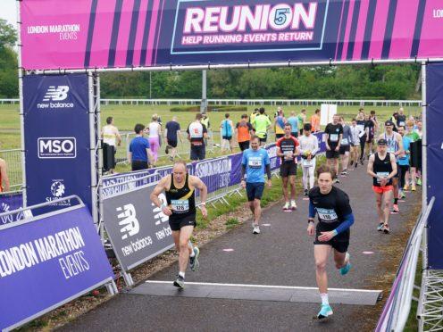 Runners take part in the Reunion 5k run at Kempton Park in Surrey (Yui Mok/PA)