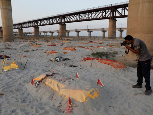 Bodies of suspected Covid-19 victims buried in shallow graves on the banks of Ganges in Prayagraj in India (Rajesh Kumar Singh/AP)