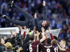 Brendan Rodgers was thrown into the air by his Leicester players after their FA Cup triumph (Kirsty Wigglesworth/PA)