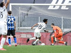 Juan Cuadrado kept his cool from the penalty spot to secure a late win (Piero Cruciatti/LaPresse via AP/Press Association Images)
