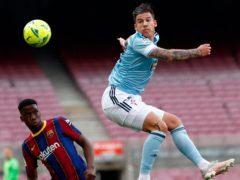 Santi Mina struck twice at the Nou Camp to end Barcelona's title bid (Joan Montfort/AP)