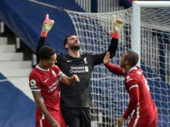Liverpool goalkeeper Alisson celebrates with Roberto Firmino (left) and Thiago Alcantara (Rui Vieira/PA)