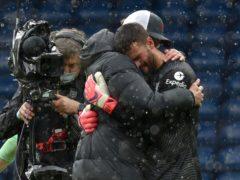Liverpool goalkeeper Alisson Becker embraces manager Jurgen Klopp (Rui Vieira/PA)