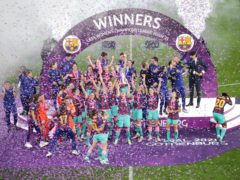 Barcelona celebrate winning the Women's Champions League (Adam Ihse/PA)