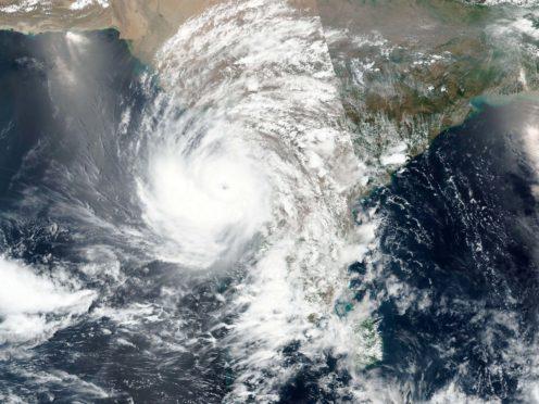 A cyclone approaching western India (Nasa/AP)
