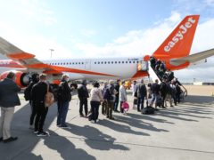 Passengers prepare to board an easyJet flight to Faro, Portugal, at Gatwick Airport (Gareth Fuller/PA)