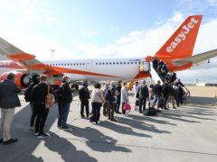 Passengers prepare to board an easyJet flight to Faro, Portugal, at Gatwick Airport (Gareth Fuller/PA)