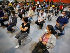 People wait to receive a Covid jab in Bangkok, Thailand (AP/Anuthep Cheysakron)