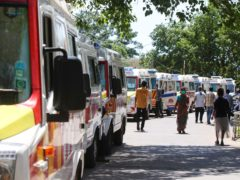 Ambulances carrying Covid-19 patients waiting at a hospital in India (R Parthibhan/AP)