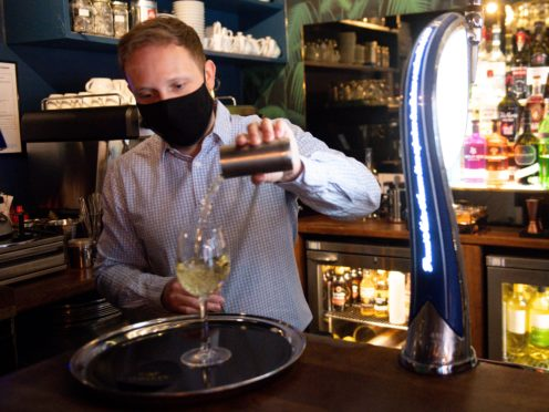 Jonathan Lea, general manager at Loxleys Restaurant & Wine Bar in Stratford, pours a drink as indoor hospitality and entertainment venues reopened to the public (Jacob King/PA)