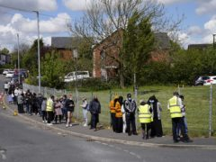 People queuing for Covid-19 vaccinations at the Essa Academy in Bolton (Danny Lawson/PA)