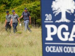 Justin Rose, left, of England, and Cameron Champ, middle, walk to the 14th green during a practice round at the PGA Championship golf tournament on the Ocean Course (David J. Phillip/AP)