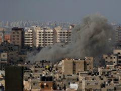 Smoke rises following an Israeli airstrike, in Gaza City (Hatem Moussa/AP)