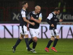 Dundee's Charlie Adam (centre) celebrates scoring his side's second goal of the game (Andrew Milligan/PA)