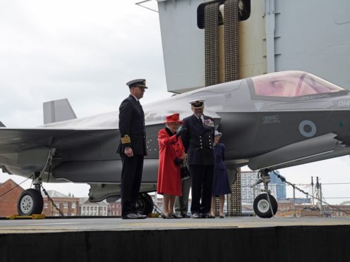 The Queen aboard HMS Queen Elizabeth at Portsmouth (Steve Parsons/PA)