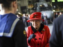 The Queen talks to military personnel during a visit to HMS Queen Elizabeth at HM Naval Base, Portsmouth (Steve Parsons/A)