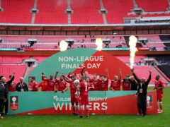 Hornchurch players and staff celebrated after winning the FA Trophy (Zac Goodwin/PA)