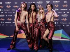Members of the band Maneskin with the trophy after winning the Eurovision Song Contest in Rotterdam (Peter Dejong/AP)
