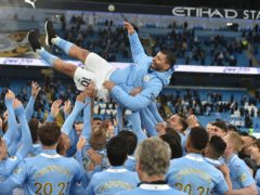 Manchester City players throw Sergio Aguero into the air (Peter Powell/PA)