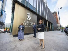 Economy Minister Diane Dodds (right) welcomes the reopening of indoor hospitality at the Grand Central Hotel in Belfast with Janice Gault, of the Northern Ireland Hotels Federation (NIHF) and general manager Stephen Meidrum (Liam McBurney/PA)