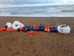 A large number of packages believed to contain Class A drugs that have been found in the sea off the coast of Sussex (NCA/PA)