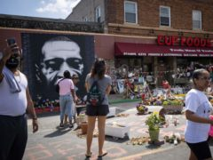 People walk through George Floyd Square (Christian Monterrosa/AP)