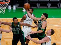 Boston Celtics forward Jayson Tatum (0) drives to the basket past the Brooklyn Nets' Blake Griffin (Elise Amendola/AP)