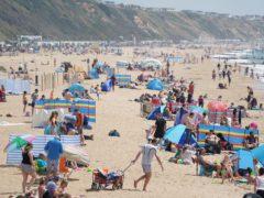 People on Boscombe beach in Bournemouth enjoying the summer sun (Andrew Matthews/PA)