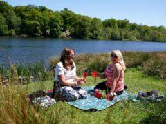 People enjoy the sunshine in Tatton Park, Knutsford, Cheshire (Martin Rickett/PA)