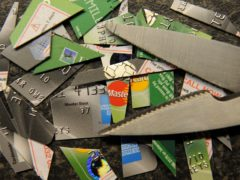 Cut up credit cards. More people struggling with their debts across England and Wales will have access to a solution which would give them a fresh start (Owen Humphreys/PA)