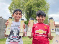 Mikaeel Ishaaq (left) and Ayaan Moosa have been raising money for causes with their lemonade (Shakil Moosa/PA)