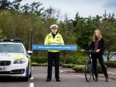 Deputy Head of Road Policing Superintendent Simon Bradshaw and Cycling Scotland Head of Communications Denise Hamilton (Cycling Scotland/PA)