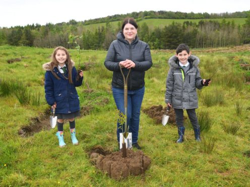 Glasgow City Council leader Susan Aitken at the inaugural tree planting (Woodland Trust/PA)