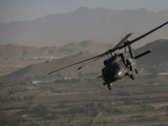 A Black Hawk helicopter over Kabul (Dan Kitwood/Archive/PA)