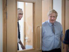 Prime Minister Boris Johnson, right, with Health Secretary Matt Hancock (Stefan Rousseau/PA)