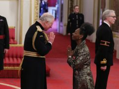 Baroness Benjamin from London is made a Dame Commander of the British Empire by the Prince of Wales (PA)