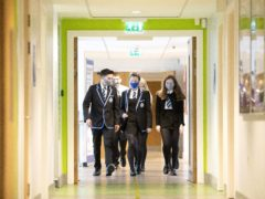 Students at St Columba's High School, Gourock, wear protective face masks as they head to lessons (PA)