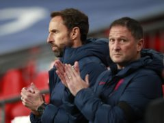 England assistant manager Steve Holland, right, does not want to shoehorn all the forwards into the team (PA)