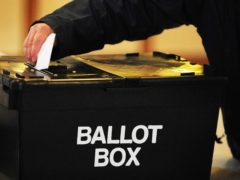 """File photo dated 6/5/201 of a voter placing a ballot paper in the ballot box. Council leaders are demanding Scotland's political parties commit to a """"menu for change"""" in the run up to May's Holyrood election – insisting this must include """"fair funding"""" for local government. Issue date: Monday February 22, 2021."""