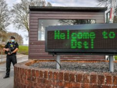 Armed police at the front entrance to Dstl at Porton Down in Salisbury (Ben Birchall/PA)