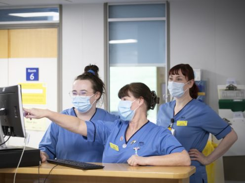 A report warns nurses are leaving the profession because they cannot afford to buy a house (Jane Barlow/PA)