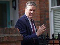 Labour leader Sir Keir Starmer leaves his north London home (Yui Mok/PA)